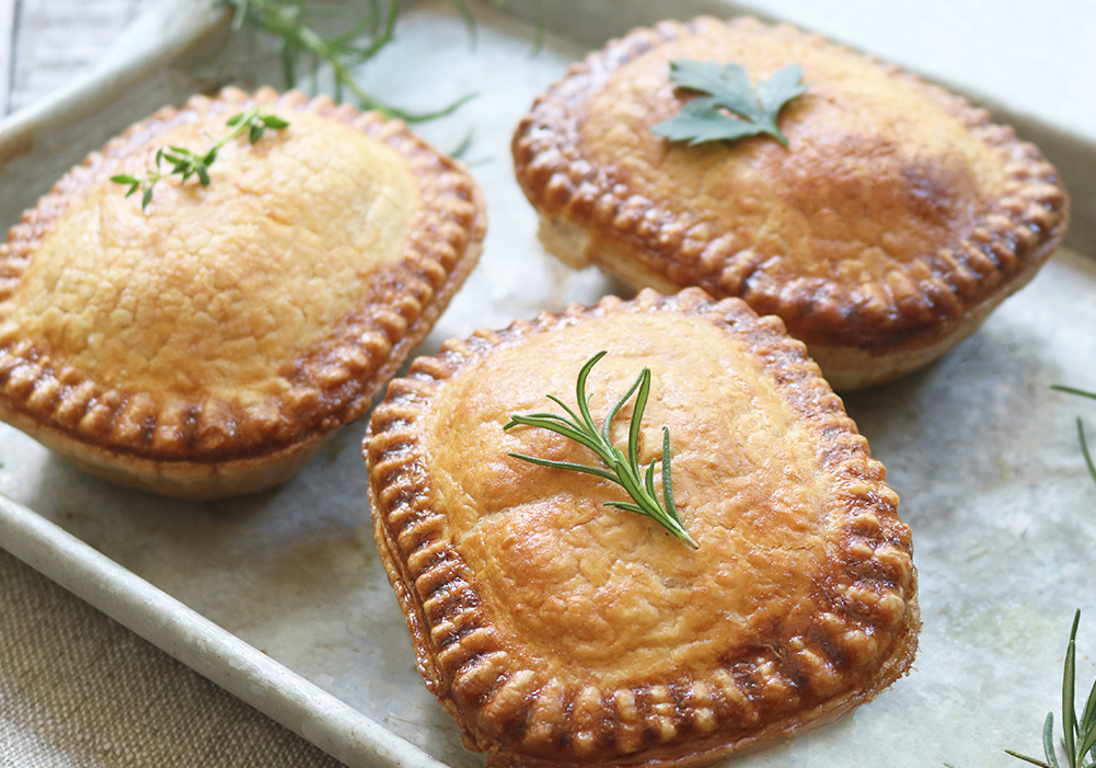 Assorted Panbury's pies on a baking tray