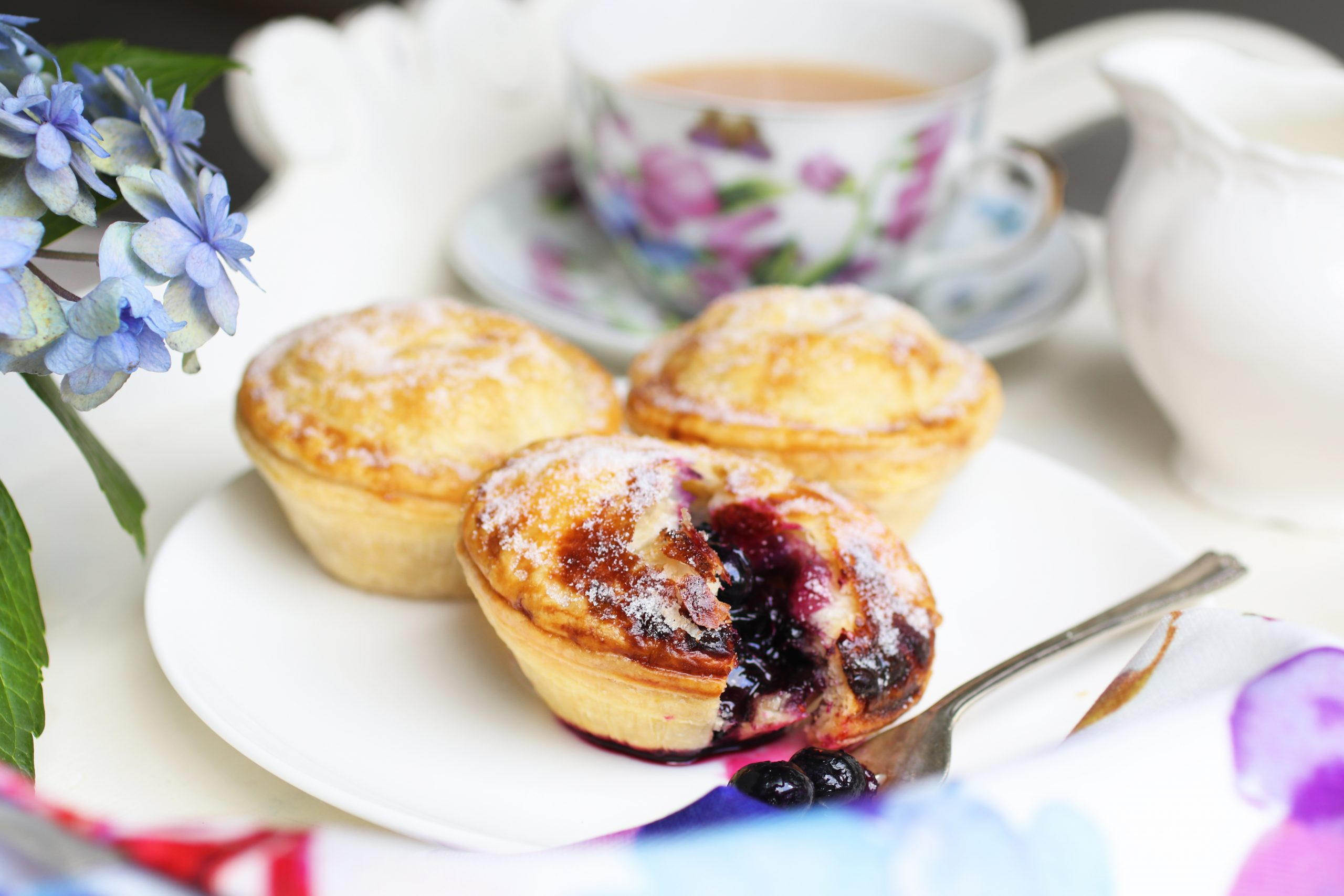 Photo of Panbury's Mini Blueberry Pies and a tea party tray