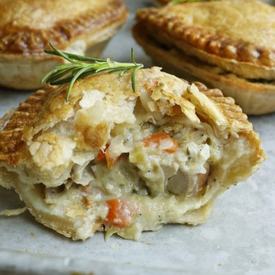 Country Chicken pie on tray with pies